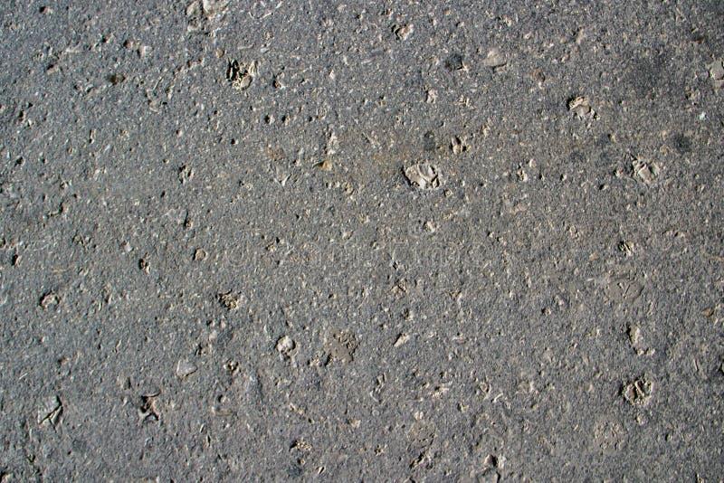 Textura de un asfalto gris del camino imagen de archivo