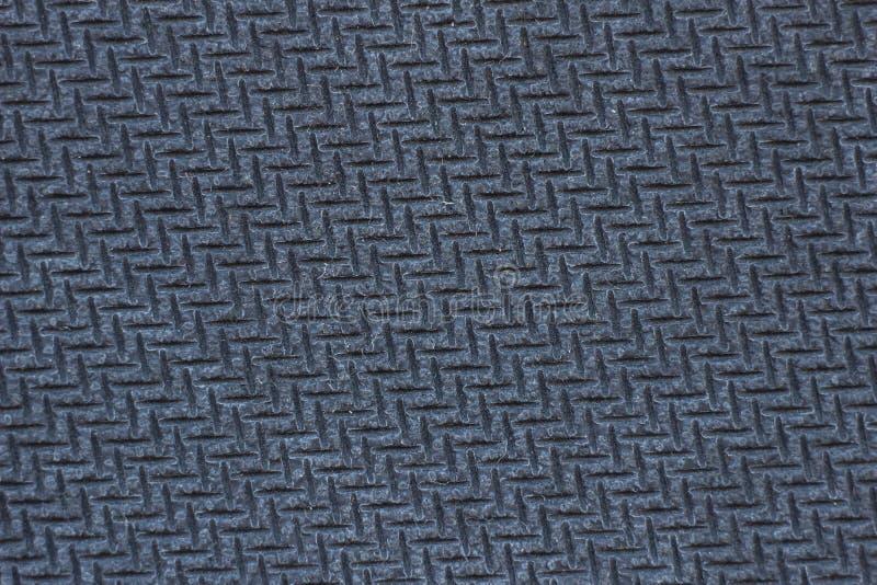 Textura de una alfombrilla de ráton de goma texturizada del ordenador, fotografía macra, textura del caucho negro, negra imagen de archivo