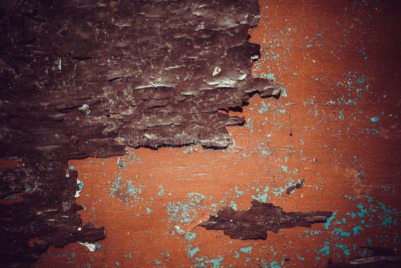Textura de una pintura anaranjada de la peladura en vieja superficie de madera fotografía de archivo libre de regalías