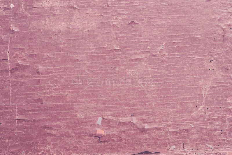 Textura de una pintura del rosa de la peladura en vieja superficie de madera fotografía de archivo