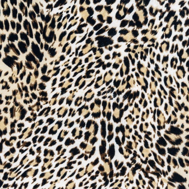 Textura del cierre encima del leopardo rayado de la tela fotos de archivo