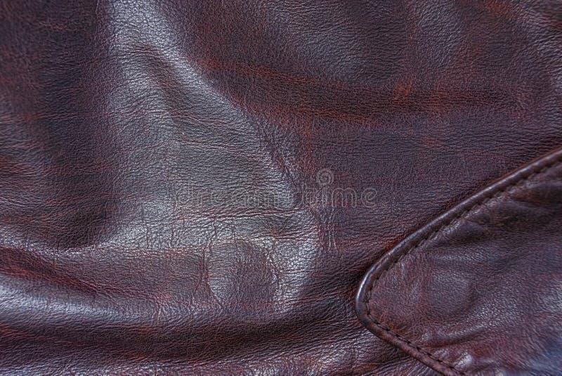 Textura del cuero de Brown de un pedazo de chaqueta y de cuello imagenes de archivo