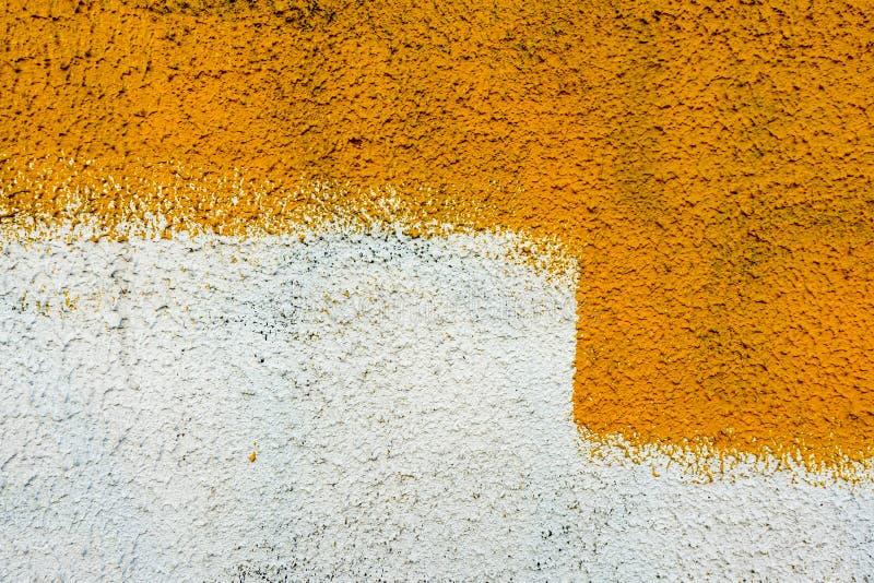 Textura del extracto de la pintura de pared, amarilla para el diseño gráfico foto de archivo