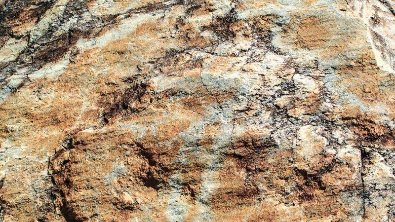 Textura del fondo de la superficie marrón de la roca fotografía de archivo libre de regalías