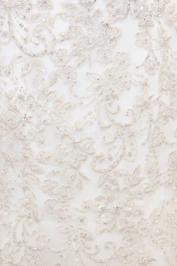 Textura del fondo de la tela blanca con bordado imagen de archivo libre de regalías