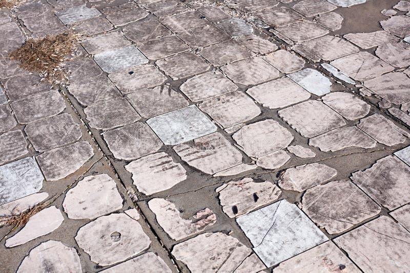 Textura del fondo de las piedras de pavimentación sucias viejas fotografía de archivo