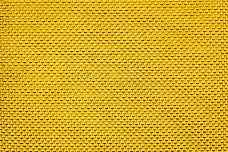 Textura del fondo del negro del polipropileno de la pana del oro imagenes de archivo