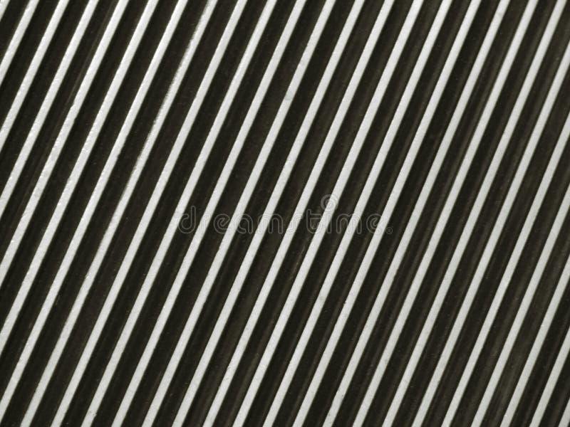 Textura del fondo del modelo rayado del negro del paso del pie de la escalera móvil del metal y de plata abstractos fotos de archivo libres de regalías