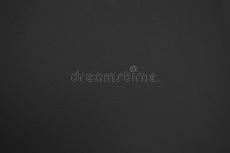 Textura del fondo negro de la pared del estuco foto de archivo