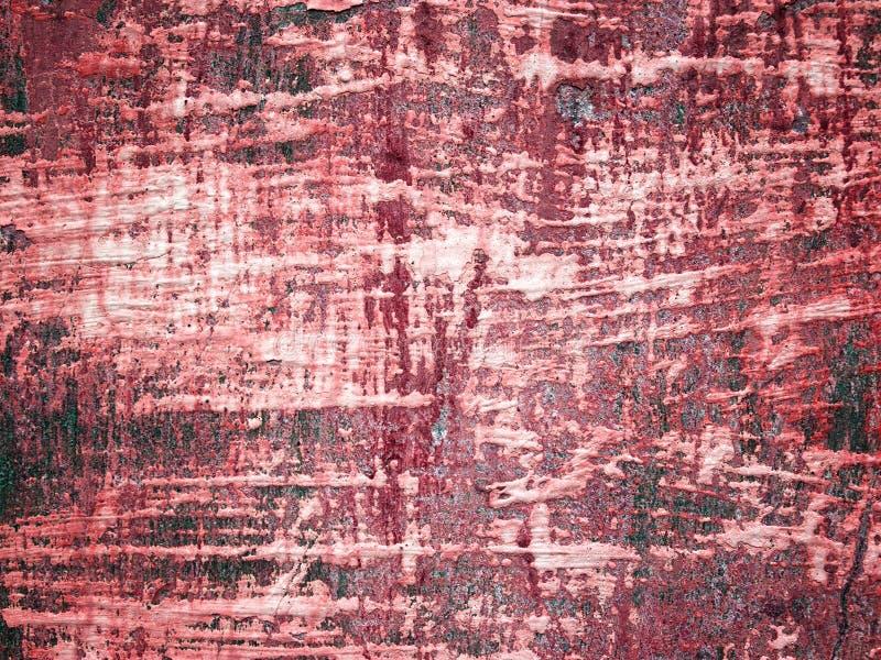 Textura del Grunge de una pared dilapidada en un tono rojo fotos de archivo
