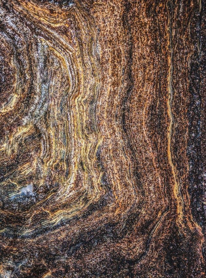 Textura del hierro oxidado Imagen de fondo fantástica Amarillo, marrón, rojo y azul Dibujo de izquierda a derecha con las líneas  foto de archivo
