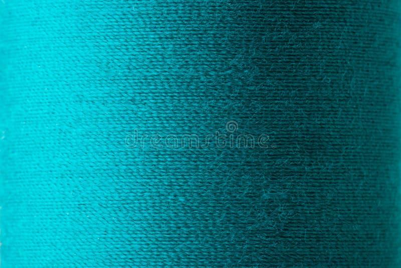 Textura del hilo ciánico en carrete imagenes de archivo