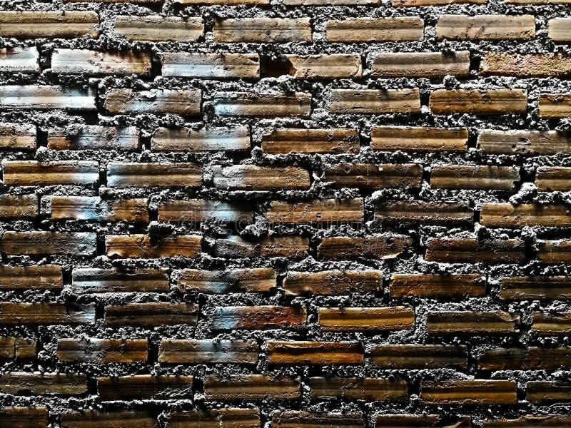 Textura del ladrillo con los rasguños y las grietas fotografía de archivo libre de regalías
