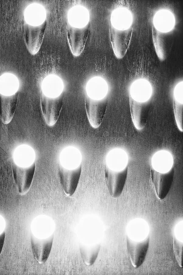 Textura del metal con los agujeros ligeros fotos de archivo libres de regalías