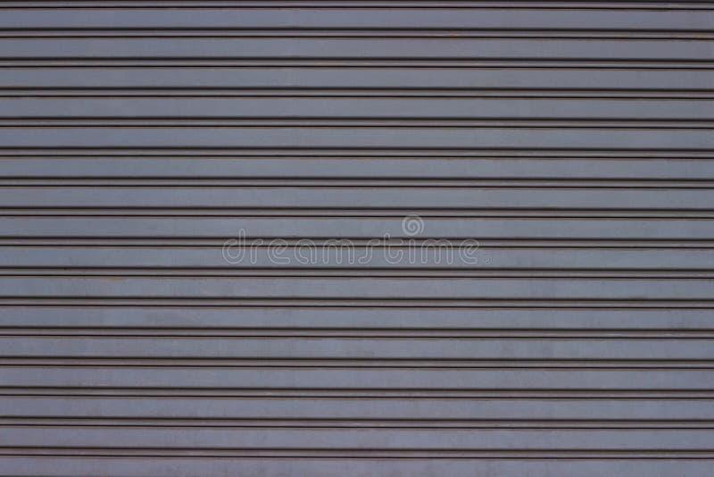 Textura del metal de la puerta del obturador del rodillo, garaje de la puerta y f?brica imagen de archivo libre de regalías
