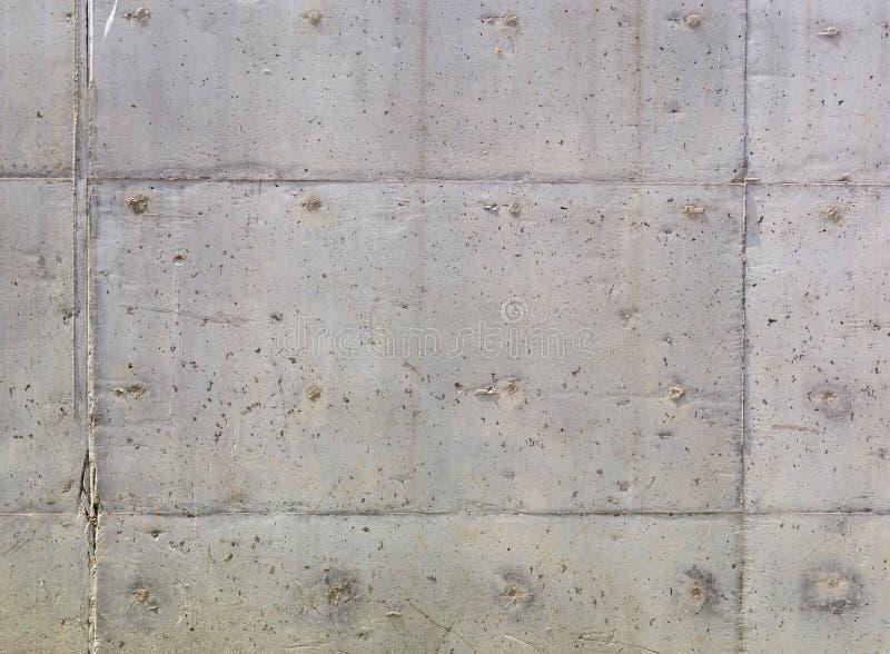 Textura del muro de cemento gris con pequeñas depresiones fotos de archivo