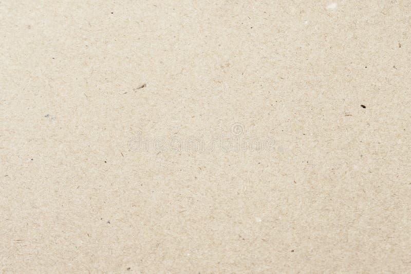 Textura del papel orgánico viejo de crema ligera, fondo para el diseño El material reciclable, tiene pequeñas inclusiones de la c fotografía de archivo libre de regalías