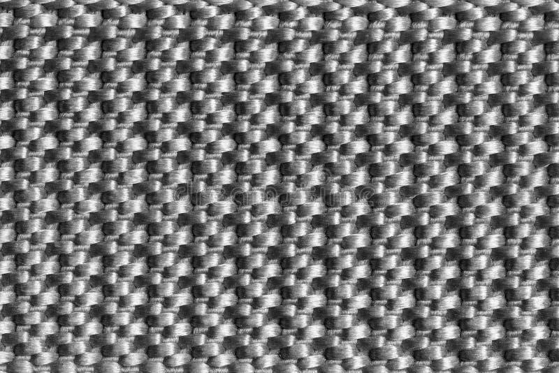 Textura del primer del color de nylon del blanco del negro de la correa de la tela imagenes de archivo