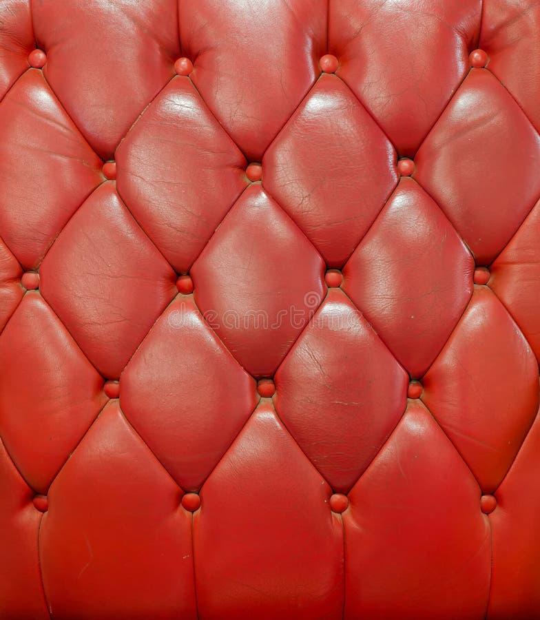 Textura del sofá de cuero rojo de la vendimia foto de archivo libre de regalías
