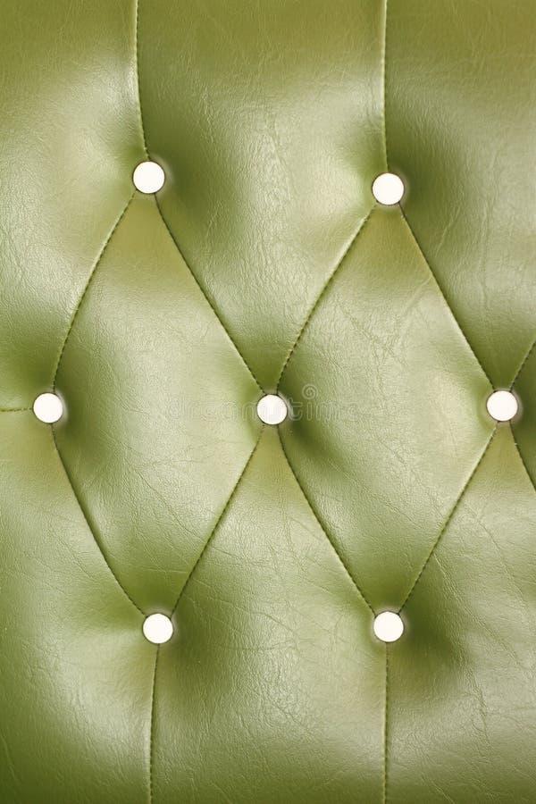 Textura del sofá del cuero del verde del vintage para el fondo imágenes de archivo libres de regalías