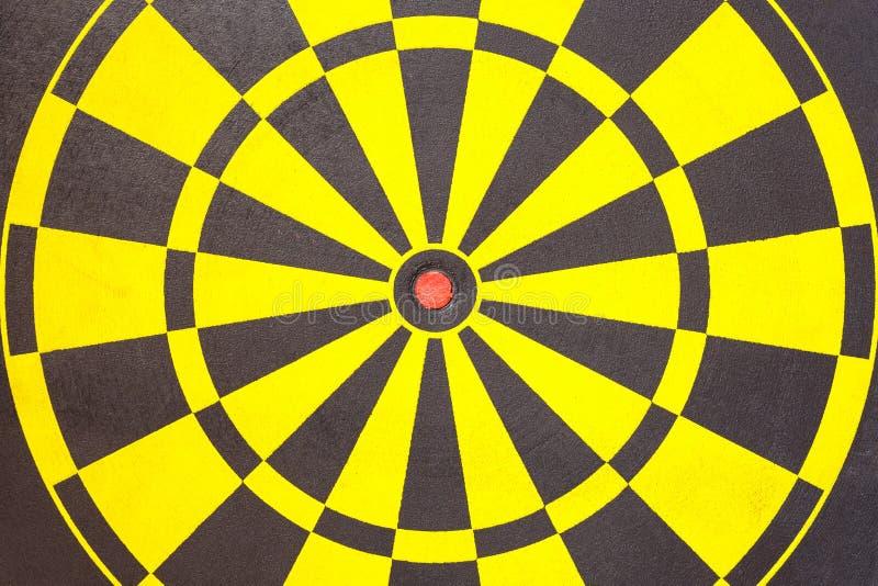 Textura del tablero de dardo amarillo y negro fotografía de archivo