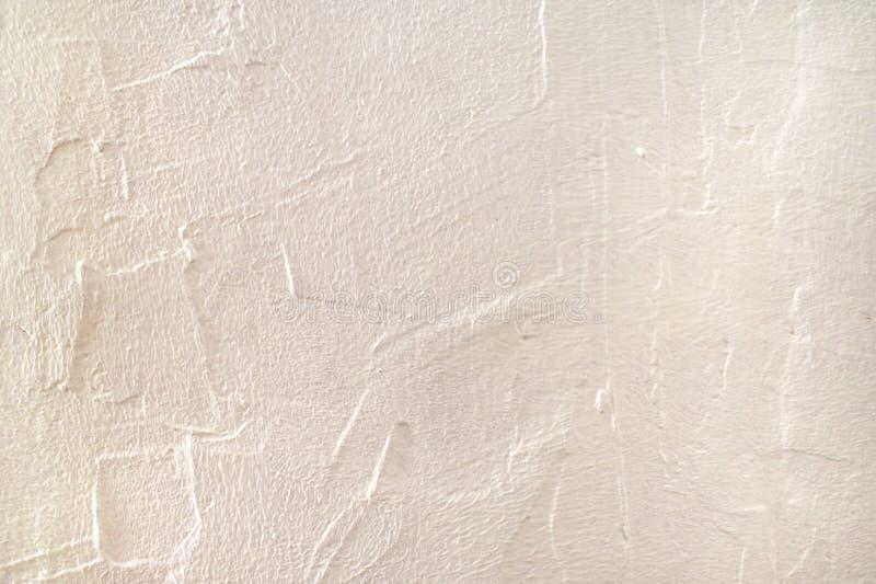 Textura del yeso de la superficie ?spera Fondo anaranjado claro rosado amelocotonado del color con el espacio de la copia Enyesad imagenes de archivo
