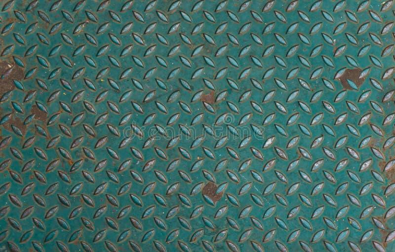Textura do assoalho do metal do deslizamento do metal verde anti fotografia de stock
