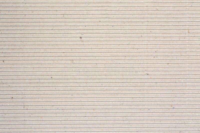 Textura do cartão ondulado para o fundo do presente do cartaz imagem de stock