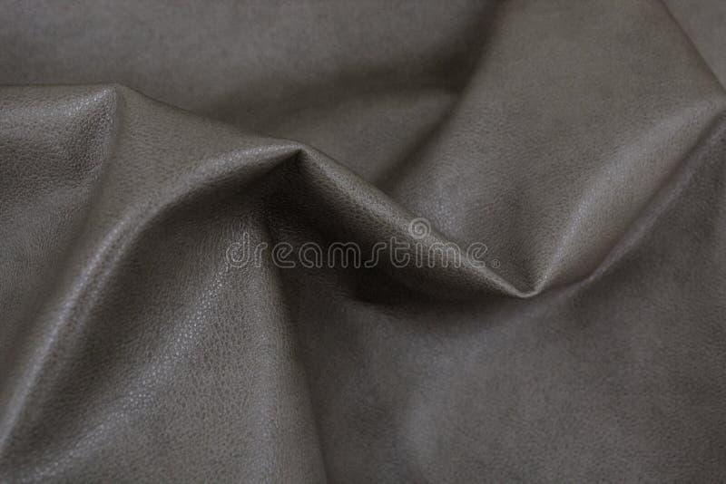 A textura do couro com espaço livre para o texto Couro genuíno para a mobília Couro cinzento fotografia de stock