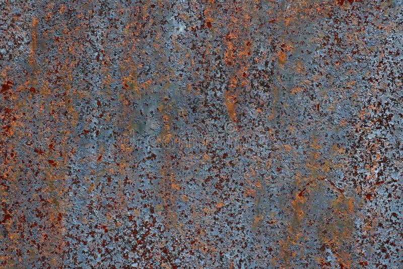 Textura do ferro oxidado, pintura rachada em uma superfície metálica velha, folha do metal oxidado com pintura rachada e flocoso foto de stock royalty free