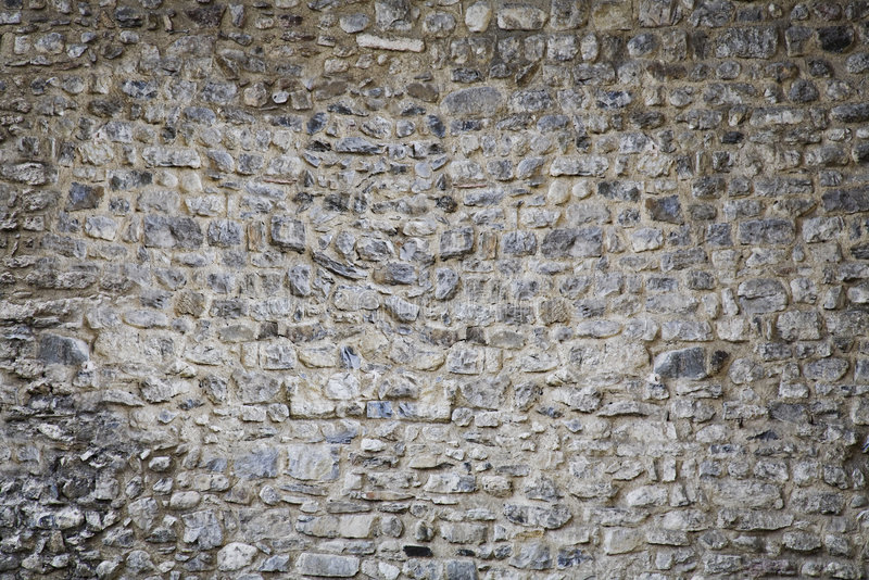 Textura do fundo da parede de pedra do castelo medieval fotografia de stock