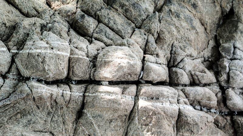 Textura do fundo da superfície marrom da rocha fotografia de stock royalty free
