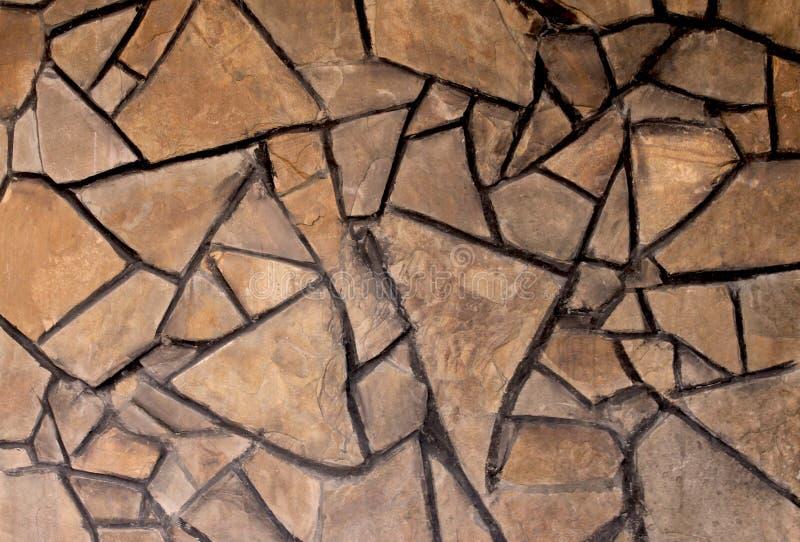 Textura do fundo de uma parede da pedra desbastada imagem de stock