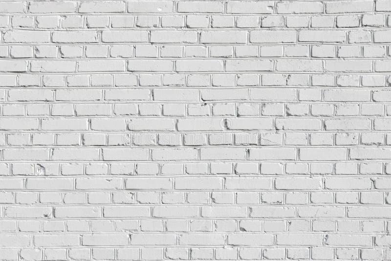 Textura do fundo de uma parede de tijolo branca imagem de stock