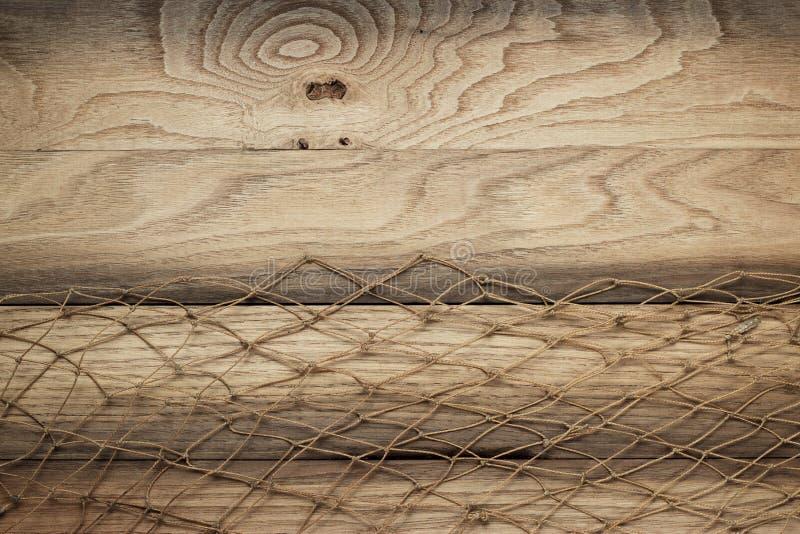 Textura do fundo e rede de pesca de madeira fotografia de stock