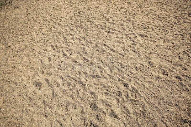 Textura do fundo do papel de parede no formulário da areia Fundos bonitos da areia fotos de stock