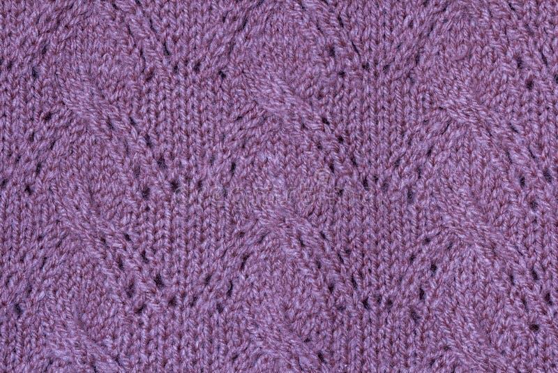 Textura do fundo teste padrão violeta da tela feita malha feita do cott foto de stock