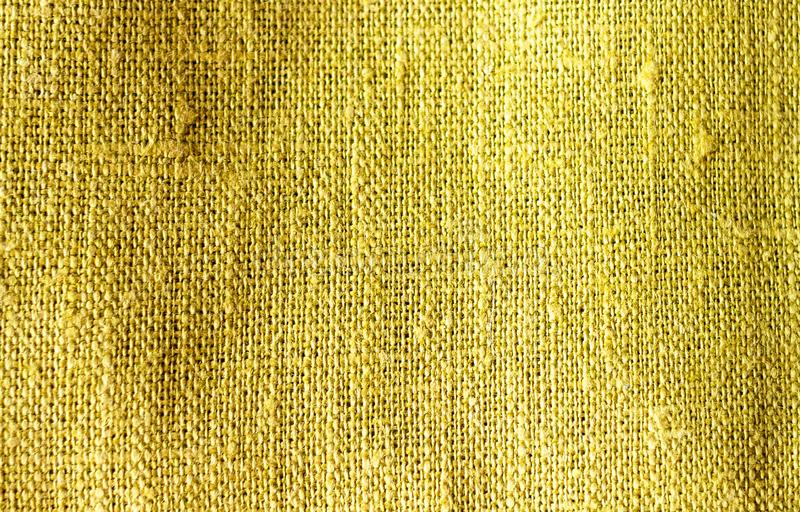 A textura do fundo verde amarelo de linho amarrotado da textura da tela da cor do cal do quivi do algodão imagens de stock