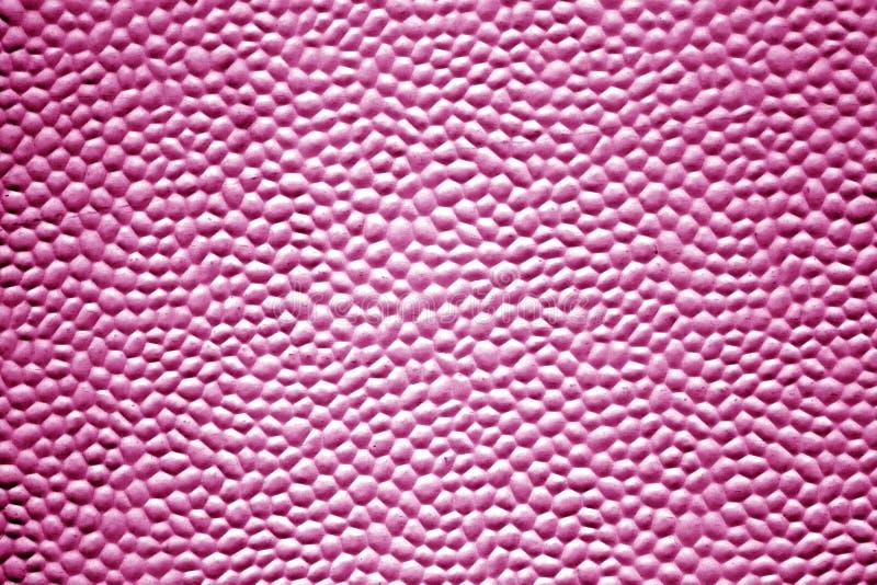 Textura do metal com bolhas na cor cor-de-rosa imagens de stock
