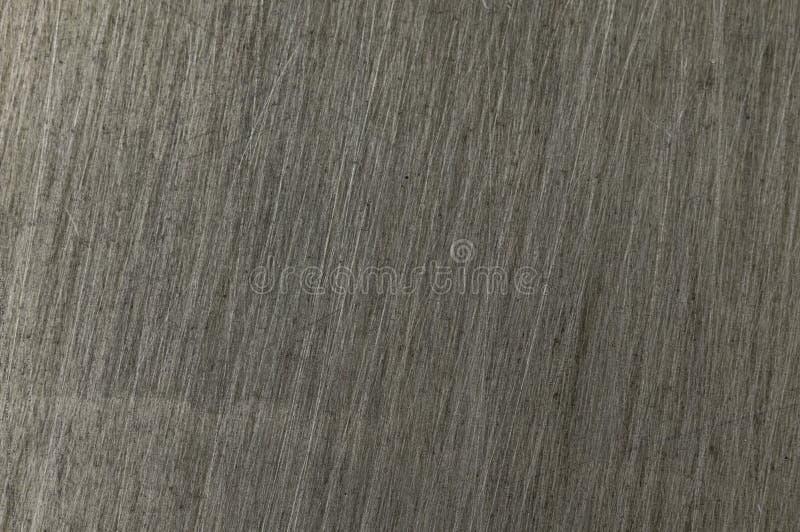A textura do metal nos riscos é cinzenta imagens de stock