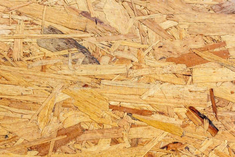 Textura do painel de madeira pressionado OSB orientou a placa da costa imagem de stock