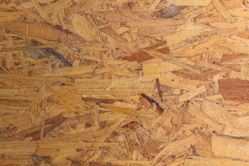 Textura do painel de madeira pressionado OSB orientou a placa da costa foto de stock
