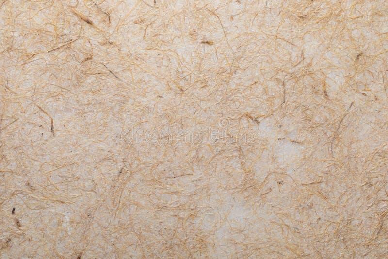 A textura do papel feito a mão com fibras vegetais gosta da palha foto de stock royalty free