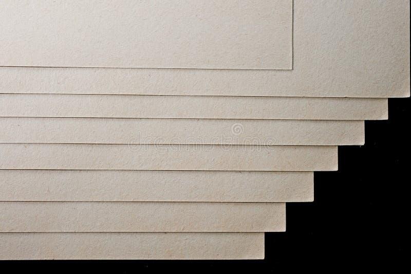 A textura do papel grosseiro, um pacote de cartão imagens de stock