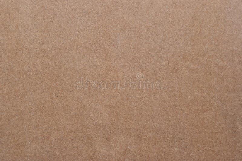 Textura do papel marrom e fundo sem emenda do cartão imagens de stock royalty free