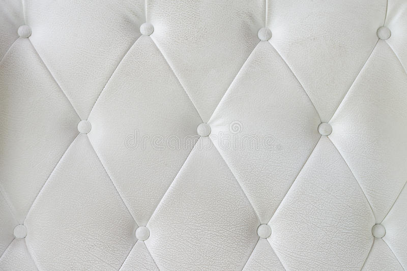 Textura do sofá do couro branco fotografia de stock