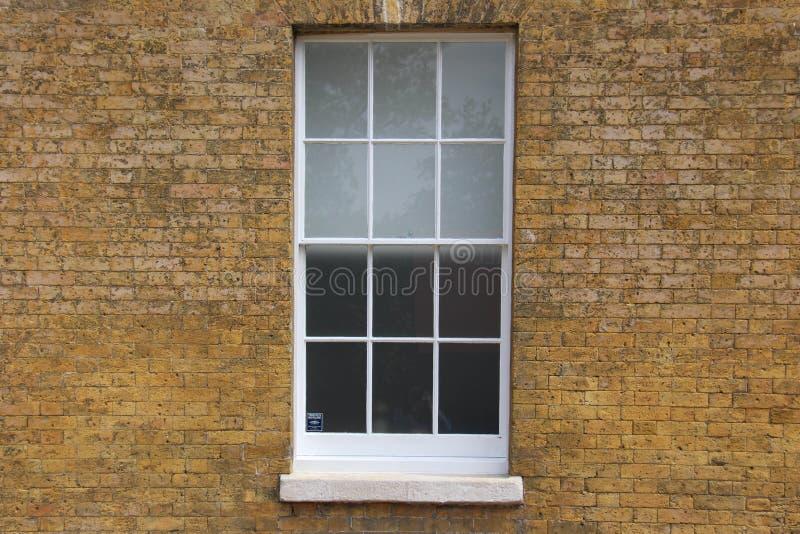 Textura do tijolo com janela imagens de stock royalty free