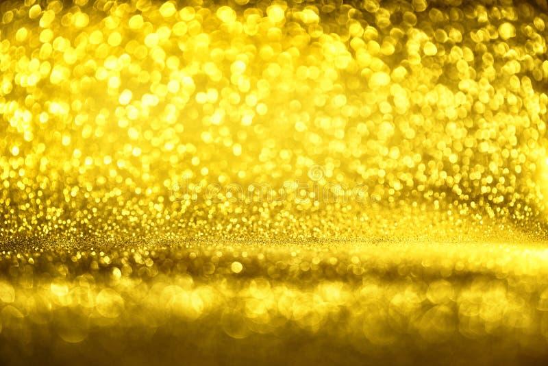 A textura dourada Colorfull do brilho borrou o fundo abstrato para o aniversário, o aniversário, o casamento, a véspera de ano no imagem de stock royalty free