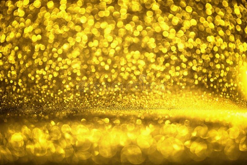 A textura dourada Colorfull do brilho borrou o fundo abstrato para o aniversário, o aniversário, o casamento, a véspera de ano no fotos de stock
