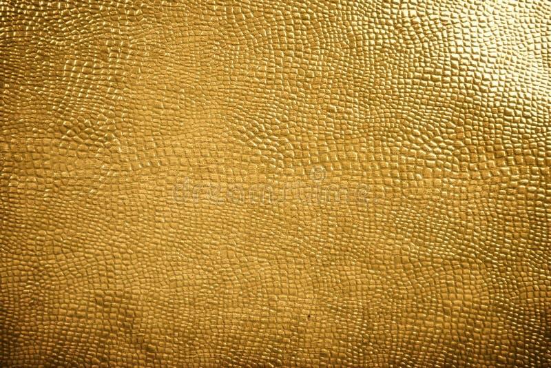 Textura dourada da pele do réptil fotografia de stock